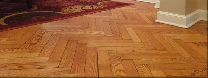 Sanding and finishing of historic herringbone hardwood flooring